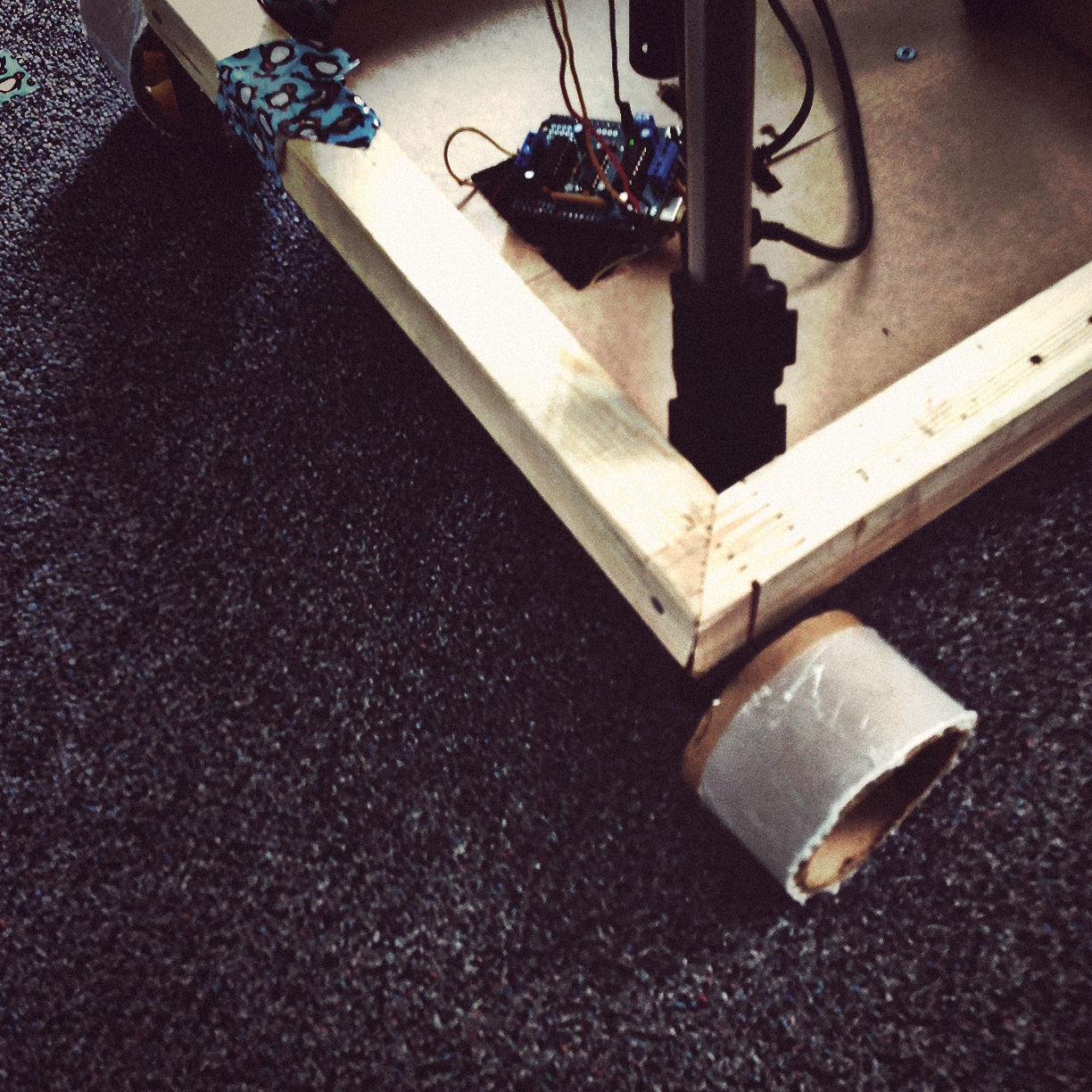 Shoot day. When the original wheels failed to gain traction on our carpet, we had to improvise.
