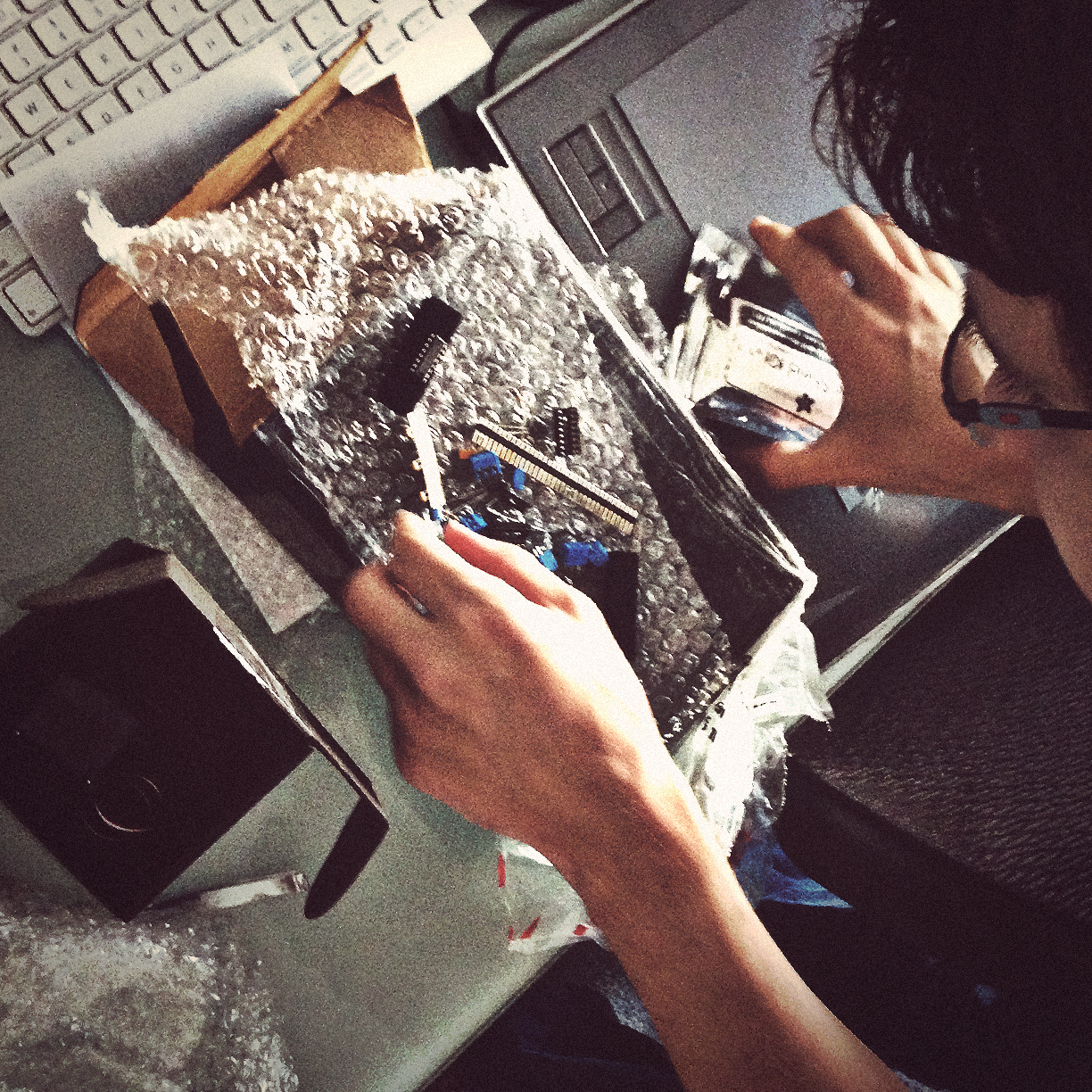 Technology. Lead developer Tyler digs into some Arduino gear for the DIY dolly rig.